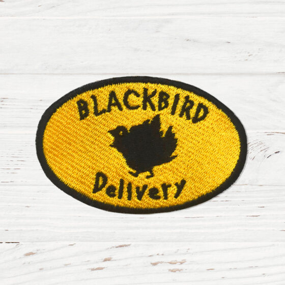 A yellow oval with the words blackbird delivery in bold. There is a blackbird in the centre.
