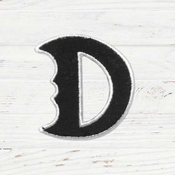 A black D with a white border. Designed to mimic the Destiny Heroes symbol.