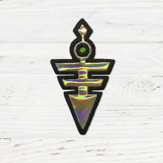 A holographic gold patch shaped like an upside down triangle.