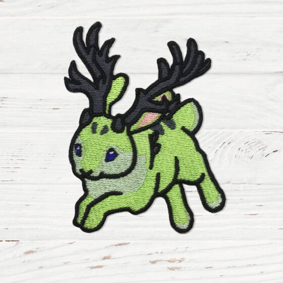 A green rabbit with antlers mid run.