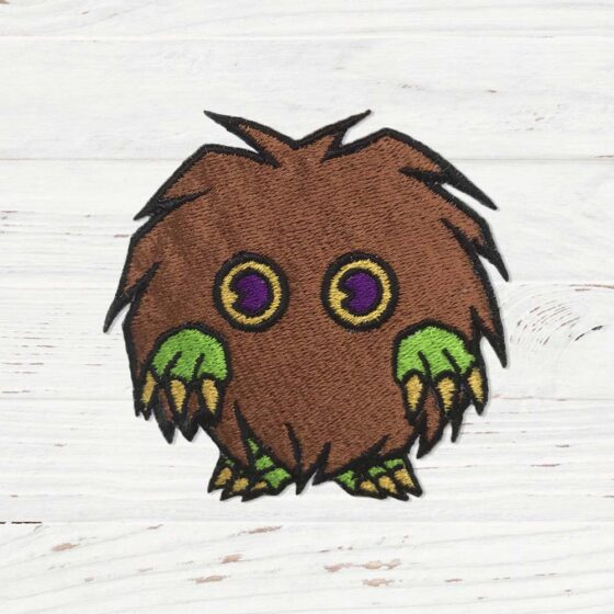 A brown fluffy creature with green hands