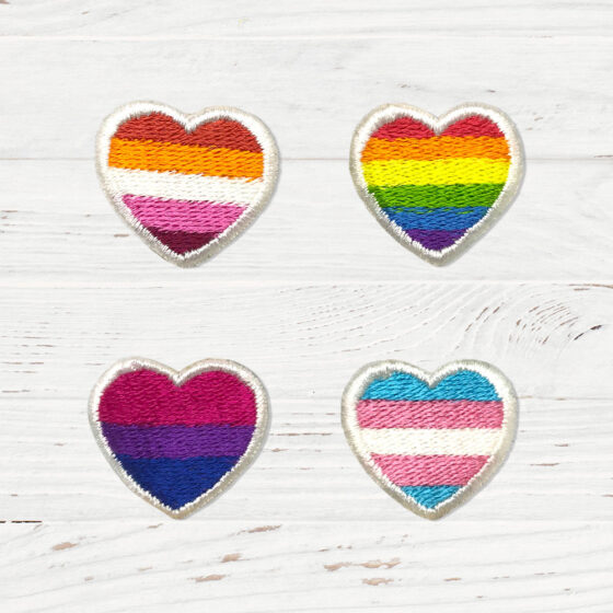 4 patches in the shape of hearts. Each heart has the flag of lesbian, gay, bi, and trans people.