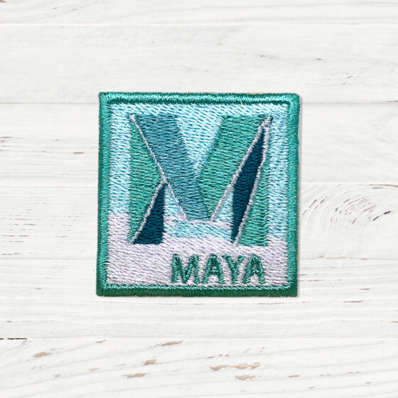 A square logo with a large M in the middle. The word MAYA is written underneath.