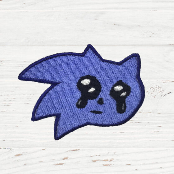 The head of Sonic The Hedgehog with teary eyes.