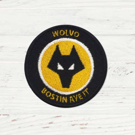 """A patch mimicking the WOLVES FC logo. The words on the patch read """"Wolvo Expats""""."""