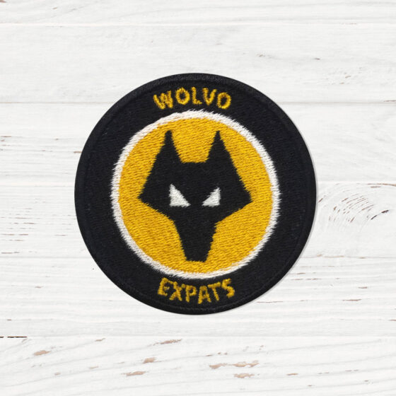 """A patch mimicking the WOLVES FC logo. The words on the patch read """"Wolvo Bostin Aye It""""."""